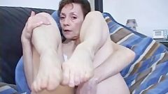 Oldie Mistress In Swimsuit Displays Her Feet For A Tease