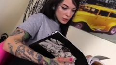 Barefoot Tattoed Female Flexes Her Toes