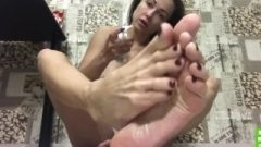 Massive Boobed Vixen In Panties Sucks Her Own Toes Before Putting Coconut Grease On